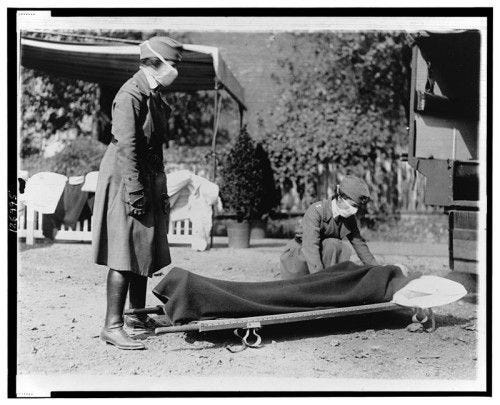 Red Cross workers carrying a victim of the Spanish Flu epidemic. Image by National Photo Company (Library of Congress[1]) [Public domain], via Wikimedia Commons