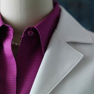 Couple Transforms Women's Lab Coat From Commodity To Featured Item