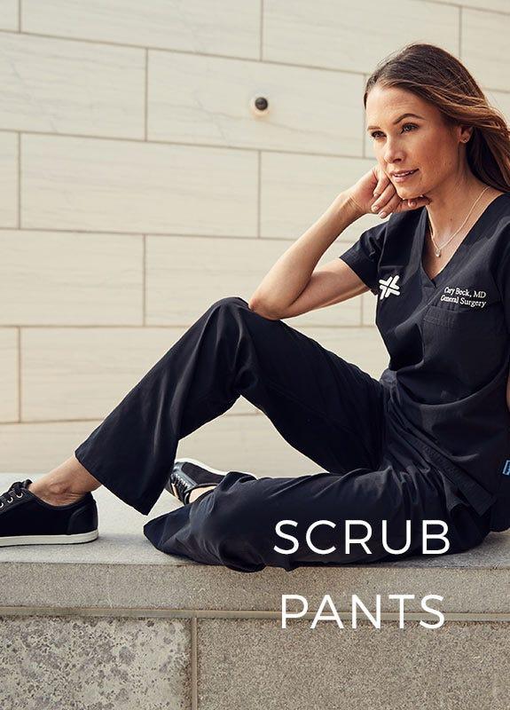 women sitting in black scrubs