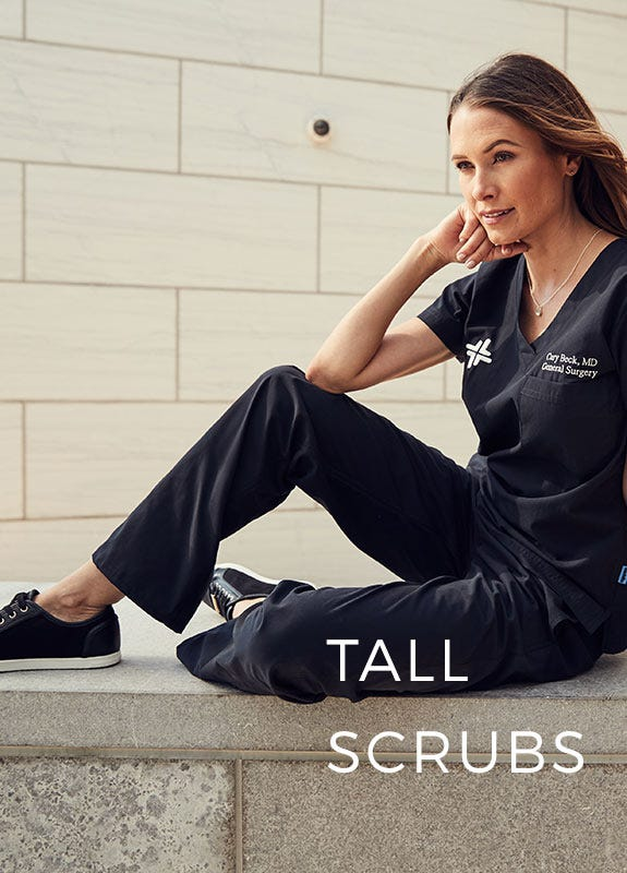 women sitting in black scrubs