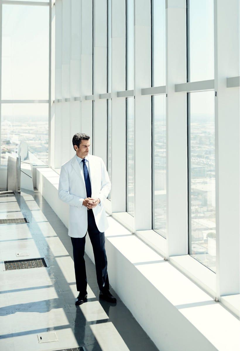man wearing lab coat