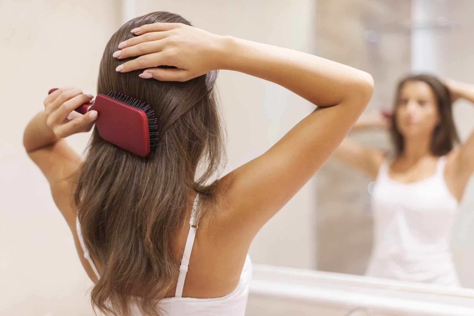 woman doing hair for her morning routine